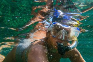 woman-wearing-goggles-and-snorkel-3040746